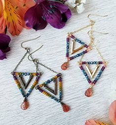 I just added these funky 🆕️ Sunstone Triangle Earrings to the S H 0 P! (l¡nk¡nb¡o) 💖 I was just playin' around over the holiday and this is what came into being! 🤗 I kinda dig 'em! What do you think!? 😘✌💖☄ 〰️〰️〰️〰️〰️〰️〰️〰️〰️〰️〰️〰️ #sunstone #gemstonelover #triangles #earrings #earringstagram #geometric #beadedearrings #gemstoneearrings #MileHighBeads #newdesign #colorlove #coloraddict #instadaily #instajewels #wahm #designerlife #creativepreneur