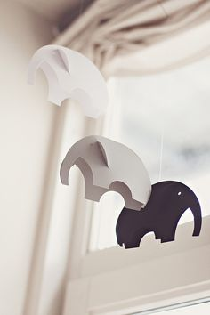 elephants.  maybe for a baby mobile?  brighter colors, though