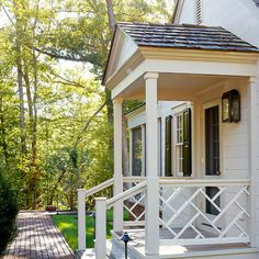 Columns and railing? Side and back porch? Def use lantern scones all 3 porches traditional-porch. Porch Railing Designs, Front Porch Railings, Front Stoop, Front Porch Design, Railing Ideas, Front Door Overhang, Pergola Ideas, Porch Kits, Porch Ideas