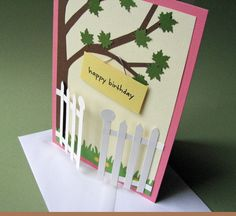 """Invitation idea: not really a pop-up card, but one with layers. Looks like a puppet theater, has Popsicle stick poking out under, which, when pushed up, makes a """"puppet"""" pop out."""