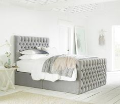 This classic bed design will be sure to add character to your bedroom. Generously padded, our bed features deep hand tufting.