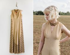 Vintage 1960s metallic gold lame jumpsuit. Features palazzo wide-leg pants, gold embellishments down both sides of jumpsuit and along neckline, fitted empire waistline, darted bust, and mod cut-out neckline. Bodice is fully lined. Metal zipper up the back with hook & eye closure. bust: 34 waist: 28 hips: 38 length: 55  best fits: Small | Medium material: gold lamé condition: excellent  Blog | www.MoonRevival.com Shop | http://MoonRevival.etsy.com Instagram | @moon.revival Facebook | Moon…