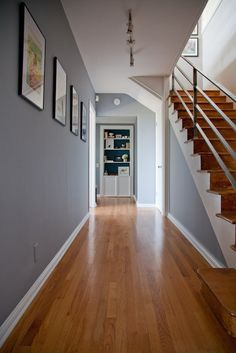 Grey walls with wooden flooring.