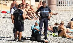 """""""French agency AFP saw a ticket given to the woman by police, which said she was not 'wearing an outfit respecting good morals and secularism'.  French police make woman remove clothing on Nice beach following burkini ban"""""""