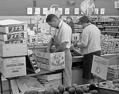 Vintage grocery store photo, stocking produce. This used to be me...not just produce. We didn't specialize in those days!