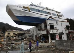 A boat still rested on a building yesterday after the March 11 earthquake and…