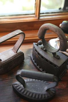 antique irons on the window sill of a laundry room (especially ironic because I loathe that chore)