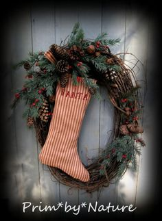 Primitive Christmas Santa Stocking Wreath Greenery Rusty Bells and Pine Cones | eBay