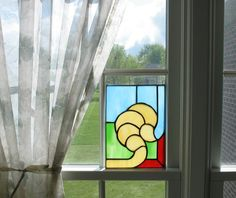 Click for a larger view. Stained glass clam shell pane