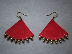 Red leather earrings with bronze metal pearls