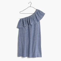 A striking one-shoulder dress with a '70s-inspired ruffle. Made of a breezy…