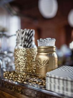 Loving these glittery gold Mason jars as party decor