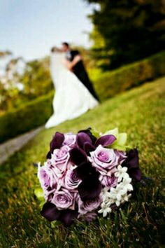 a great purple lily and rose bouquet