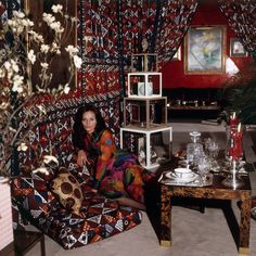 Diane von Furstenberg lounges in her Javanese fabric draped hallway in her New York City apartment. Photographed by Horst P. Horst, Vogue