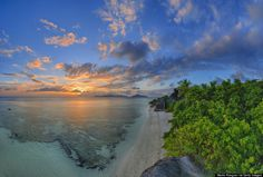 Say hi to La Digue. It's an island in the Seychelles, a world away from where you currently are. Clocking in at about three miles long, the island. Heaven On Earth, Seychelles, Travel Inspiration, River, Island, Explore, Mountains, Sunset, Landscape