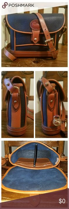 Vintage Dooney & Bourke AWL Dover Case This D&B All-Weather Leather Dover Case, Navy w/British Tan trim is in excellent vintage condition. Very minor wear or patina showing on the trim. The adjustable shoulder strap does have a spot in it (1st pic on the left). Interior is immaculate; 1 zipper pocket, slip pocket w/snap & 1 slip pocket. 1 exterior back pocket w/tab closure. Hanging brass duck fob. Serial #A2489853. From my 🚬🆓🐶🐱🆓🏠. Please do NOT comment about pricing or try to negotiate…
