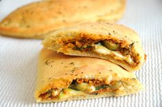 Homemade #Vegan Calzones with Sun-Dried Tomato and Pesto Spread - Get ready to have your mind blown. These calzones are out-of-this-world DELICIOUS!