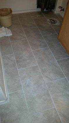 TrafficMASTER Portland Stone Gray 12 in. x 24 in. Glazed Ceramic ...