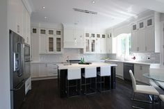 Modern painted off white kitchen, solid wood stained island, built in fridge and microwave. Kitchen Cabinet Makers, Kitchen Cabinet Remodel, Modern Kitchen Cabinets, Kitchen Tops, Kitchen Cabinet Design, Modern Kitchen Design, Kitchen Countertops, Kitchen Ideas, Off White Kitchens