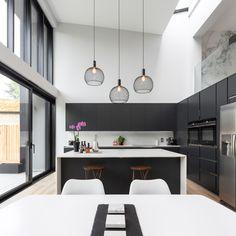 A stunning matt black handless kitchen set against crisp white walls creates a stunning, timeless design. Kitchen Room Design, Kitchen Sets, Open Plan Kitchen, Modern Kitchen Design, Kitchen Interior, Kitchen Trends, Kitchen Pantry, Ramsey House, Minimalist Kitchen