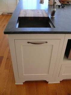 12 Awesome Kitchen Hacks For Keeping A Super Clean Kitchen - here a cutting board and opening are positioned above the trash can. Kitchen Hacks, Kitchen Reno, Kitchen Pantry, Kitchen Remodel, Kitchen Compost Bin, Kitchen Ideas, Kitchen Island Stove, Kitchen Trash Cans, Hidden Kitchen