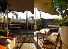 Enjoy a sundowner on the rooftop venue, The Living Room, in Maboneng with a stunning view of the Joburg skyline. Garden Bar, Rooftop Garden, Garden Ideas, Johannesburg Skyline, Cape Town Hotels, Narrow Garden, Best Rooftop Bars, Cool Bars, Africa Travel