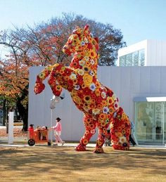 contemporary artist Choi Jeong Hwa weaves a tapestry of flowers in the shape of a horse! Its energy is livening.