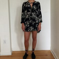 Free People - Black Floral Dress/Tunic Black Free People dress with white floral pattern. Very versatile, comfortable bohemian-chiq piece. Can be worn as a dress as seen in the photos, or a tunic like top with pants or shorts. Can be dressed up or down. Light material with neck closure - can either be worn buttoned or unbuttoned. Sleeves are tight around the wrist (somewhat elastic), can be worn rolled up or all the way down to the wrist. Hardly worn. Thanks for viewing xx Free People…