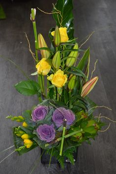 Arrangement in a container Yellow Roses, Oriental Lilies , Ornamental Kale
