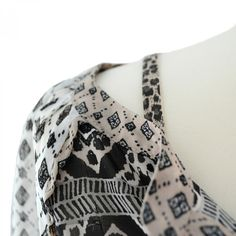 Leopard Print Beige bra straps matched with beige patterned blouse.