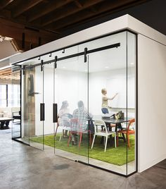 Our new Ragnar sliding door design used in a glass conference room here in our Portland, OR headquarters. Krownlab's sliding barn door hardware fits in from modern to industrial.