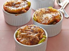 Slimmed-Down Chicken Pot Pie : These satisfying pot pies are filled with chicken breast meat, carrots, mushrooms, celery and turnips and are topped with just a few sheets of phyllo dough.