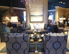 We're still obsessing over teals and grays mixed together. And check out the lines on this sofa! So pretty. Such a statement!