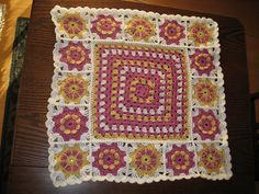 Ravelry: sunrise2104's Baby blanket #8.  Love the colors and the squares around the granny middle.