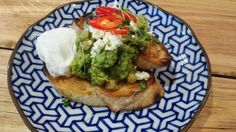 Smashed avocado and chickpeas on sourdough with a poached egg from The Spotted Owl Cafe, Sunbury.