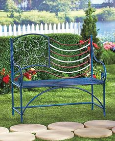 """The American Flag Outdoor Bench gives your home a patriotic look all season long. It provides a decorative accent and adds seating on your front porch or out in your yard. Made of curvy colored metal, the back of the bench suggests the American flag. 40"""""""