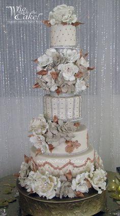 This royal wedding cake has sugar paste flowers, bling & rose gold accents. #royalweddingcake #blingweddingcake #rosegoldweddingcake #floralweddingcake