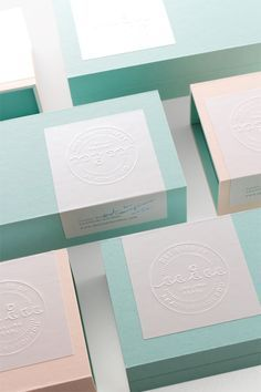 Packaging design win – embossed labels on colourful boxes.