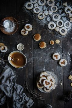 rosemary + salted caramel linzer cookies   two red bowls