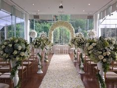 Lovely white and wood indoor wedding decoration | Project by Padma Hotel Bandung http://www.bridestory.com/padma-hotel-bandung/projects/holly-matrimony1430363146