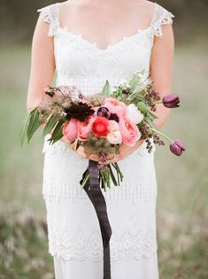 mountain bouquet and elegant wedding dress. #laurelridgecc #weddingdress #weddingflowers