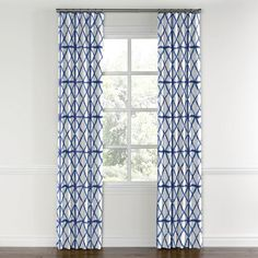 Dress up windows in a classic blue and white color scheme with an updated tie dye shibori pattern from Loom Decor. Customize in over 6 different drapery styles.