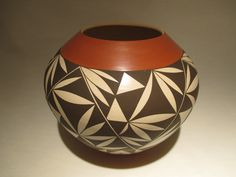 Laguna/Hopipot made by very highly regardedpotter Yvonne Lucas. Yvonne brings her Laguna Pueblo Potteryroots together with the HopiPottery styles and traditions of her husband, Steve Lucas. This VERY attractive piece is approximately 6 3/4″ tall, and 7 ″ in diameter. Please watch the quick video!