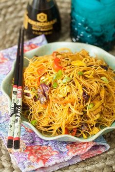 Singapore Mei Fun - Soft rice noodles, sauteed with crisp tender vegetables in a spicy sauce