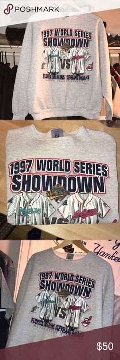 1997 Vintage World Series Sweatshirt Marlins Hey Guys!  This is an incredible find - A 1997 Seattle Marlins Vs. Cleveland Indians World Series Jacket! This is as Vintage as these sweatshirts get.  - The brand is Logo 7 and it is a Large. - Also, it looks like it has been cut around the neck but it fits great  -Due to its 20 year old life it has be subjected to some shrinkage so it can comfortably fit a Medium or a Large  Tags:  World Series, Marlins, Seattle, Indians, Cleveland, Baseball…