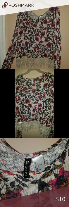 Floral patterned long sleeve Long sleeve shirt from H&M. Pretty floral patterns and details. Size Large. Feel free to ask questions! Happy Poshing :) Divided Tops Tees - Long Sleeve