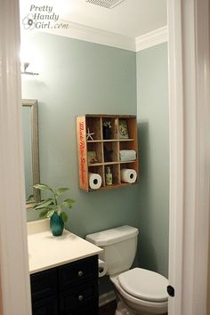 Creative bathroom storage. I've seen these at hobby lobby, now I know what to do with it Blue Paint Colors, Camper Bathroom, Barn Bathroom, Downstairs Bathroom, Small Bathroom, Bathroom Ideas, Design Bathroom, Bathroom Interior, Modern Bathroom