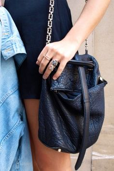 11 Gorgeous Handbags Spotted On The Streets Of D.C. A slouchy, leather Alexander Wang duffel and some cool finger-bling? We love it.