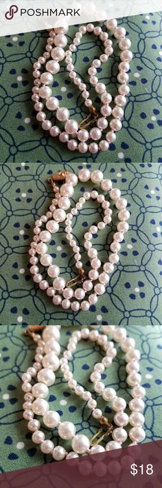 Vintage pale pink faux pearl strand necklace gold This classic vintage necklace is made of lustrous, individually knotted,  pale pink faux pearls. It has a gold tone clasp. This necklace is in very nice condition and is from a smoke free home:)  8885pink7g5d Vintage Jewelry Necklaces