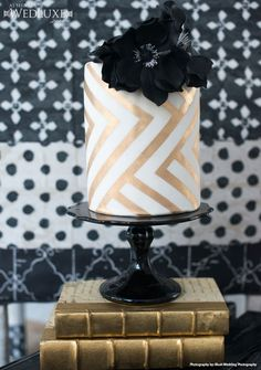 White Fondant Cake With Black Gumpaste Flower and Gold Luster Stripes. Gorgeous Cakes, Pretty Cakes, Amazing Cakes, Chevron Cakes, Patterned Cake, Striped Cake, Bolo Cake, Modern Cakes, Cake Gallery